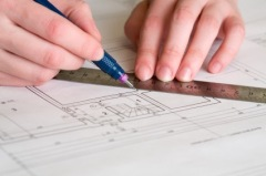 Draftsperson works on a drawing