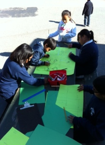 Students work on designs at recess